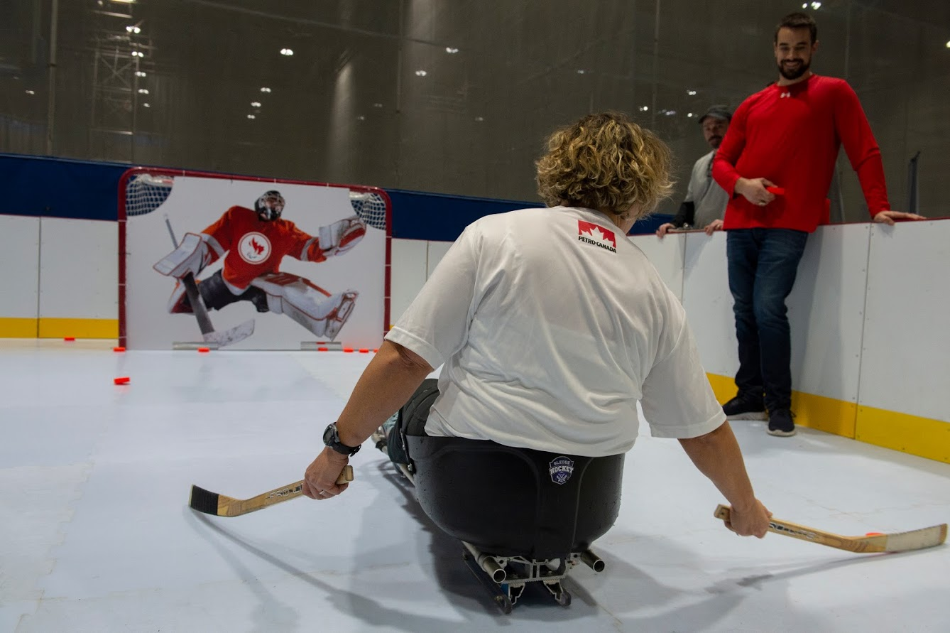 A woman playing para ice hockey