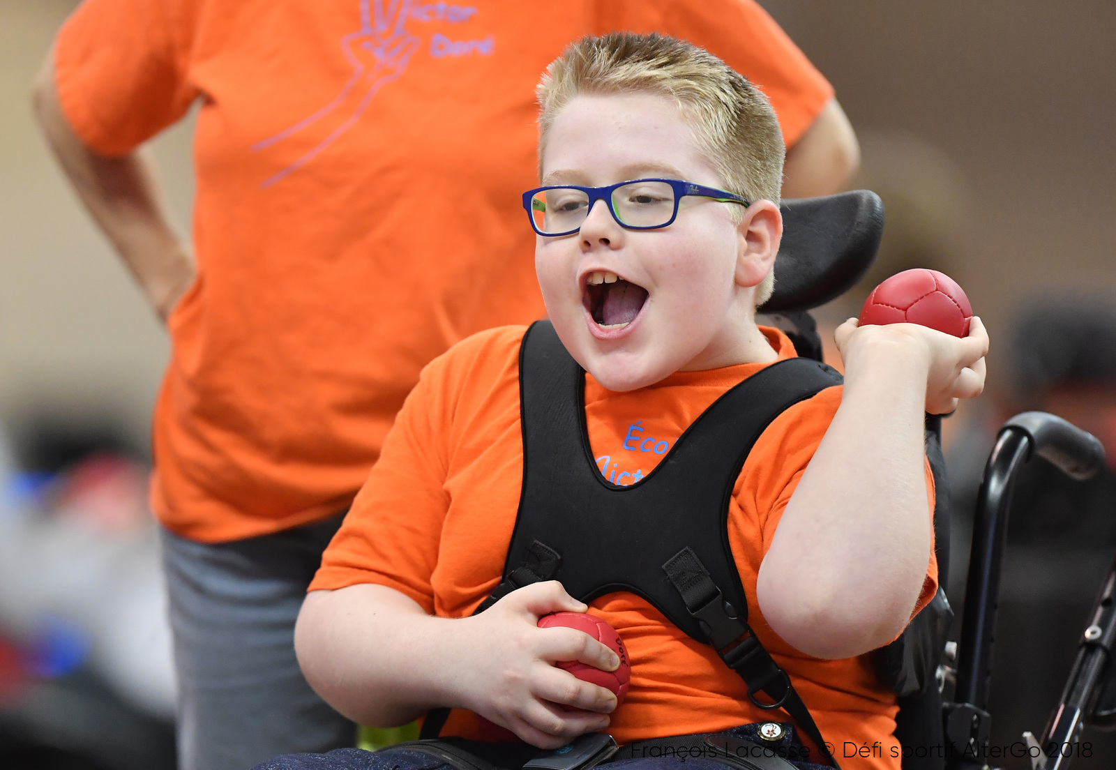 A young participant with the Association québécoise de sports pour paralytiques cérébraux throws a boccia ball.