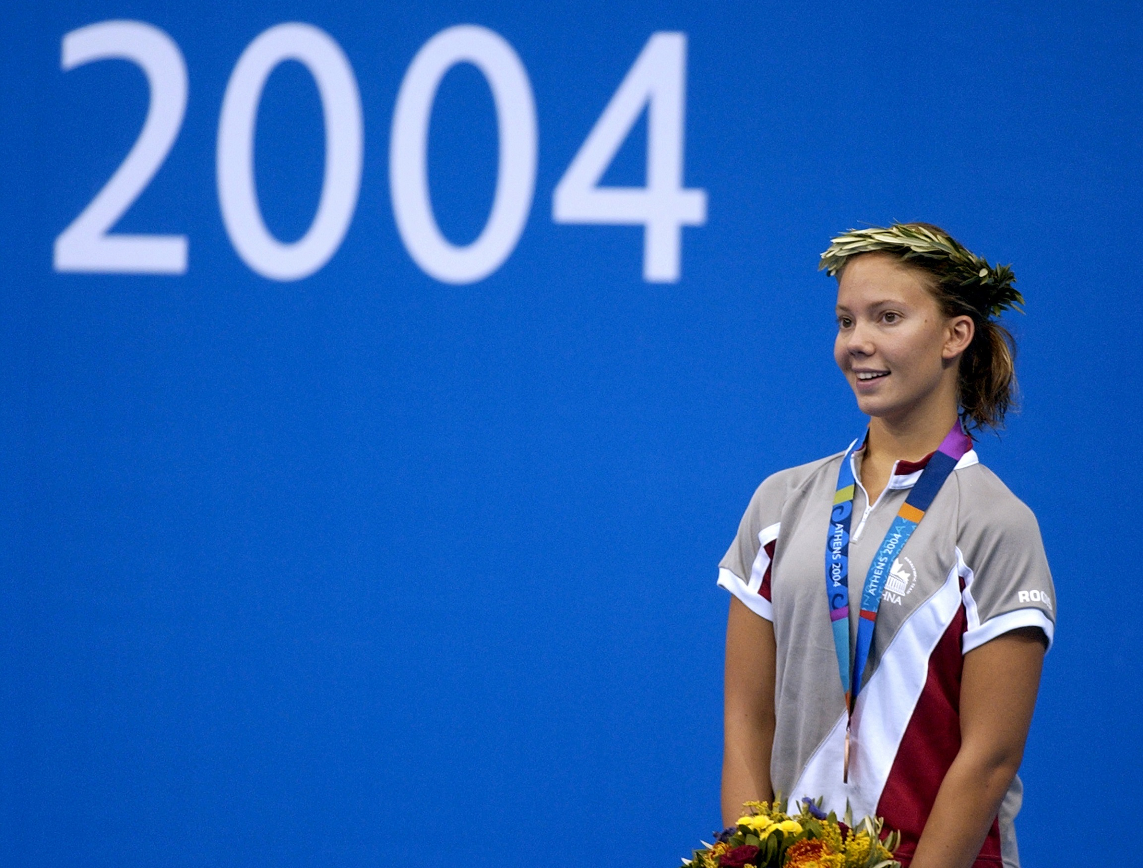 Danielle Campo standing on the podium at the Athens 2004 Paralympic Games.