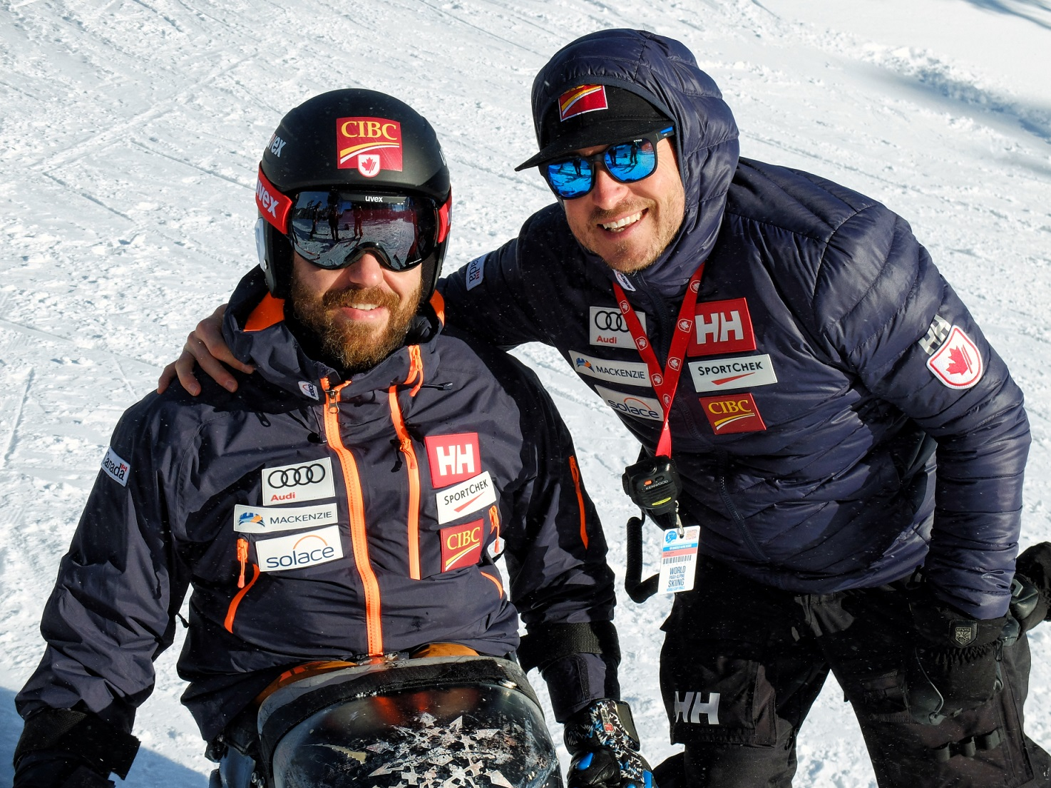Coach Jean-Sebastien Labrie (left) with Para alpine skier Kurt Oatway (right)