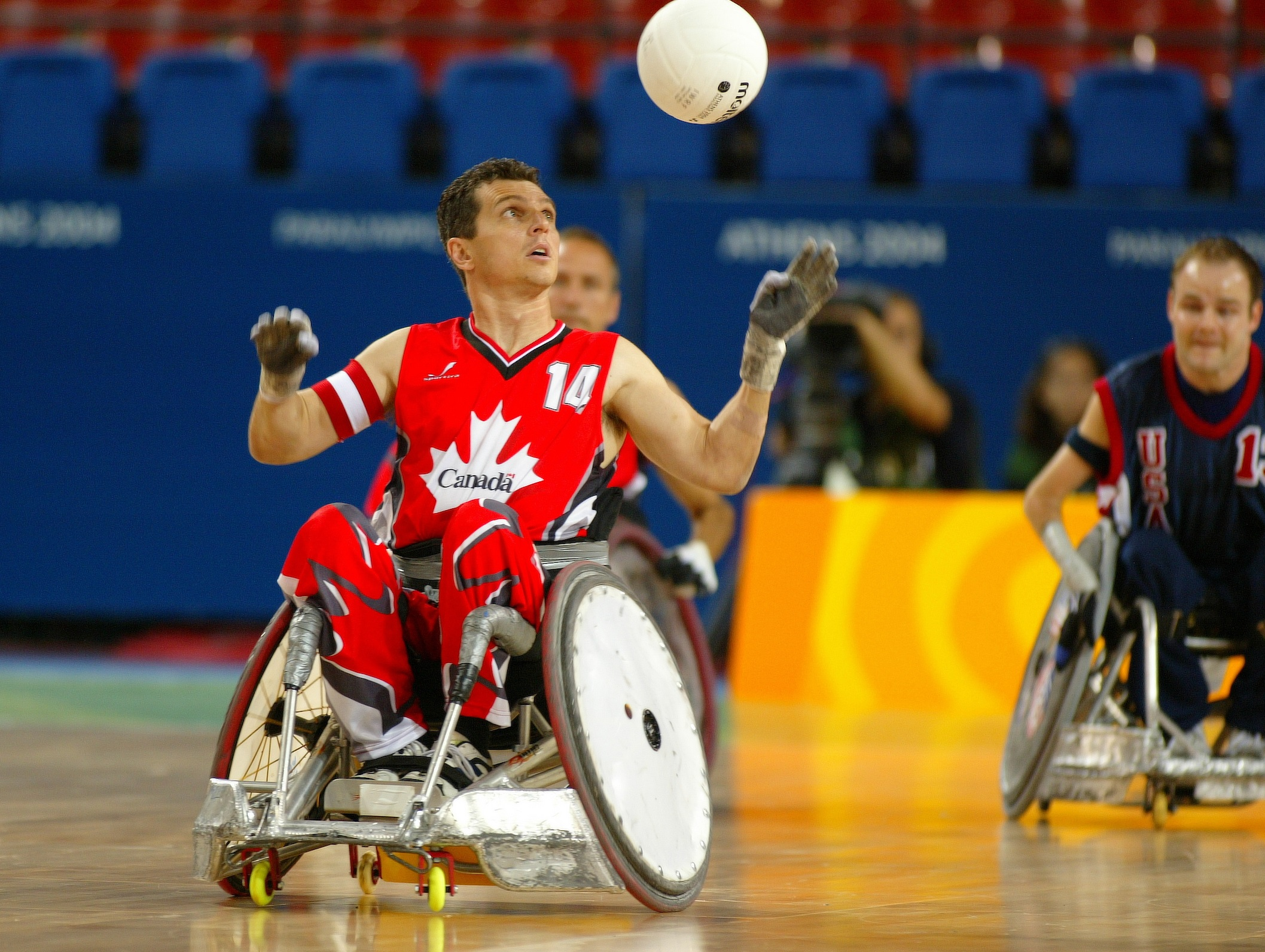 David Willsie in wheelchair rugby action about to catch the ball