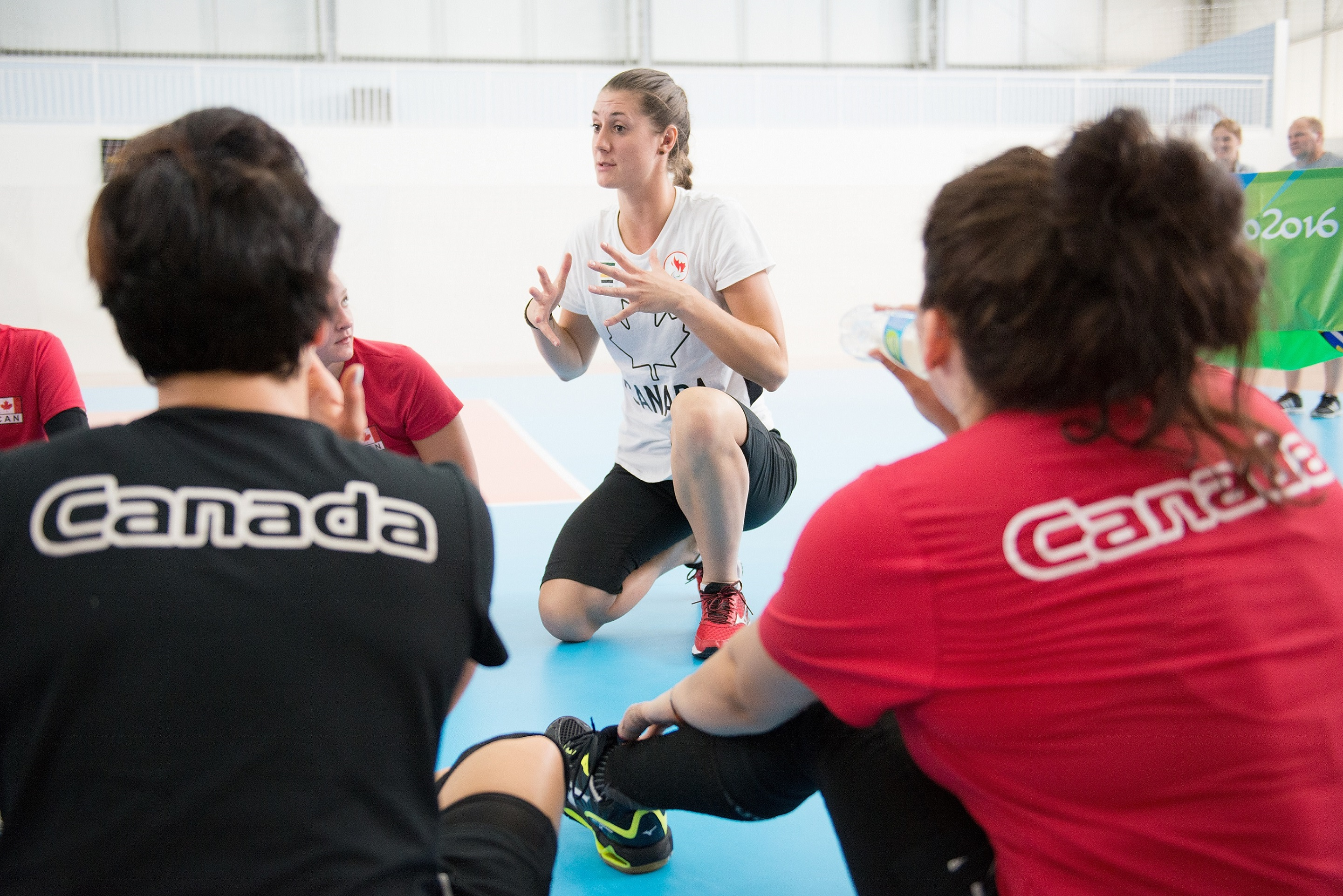 Sitting volleyball head coach Nicole Ban speaks to her team.