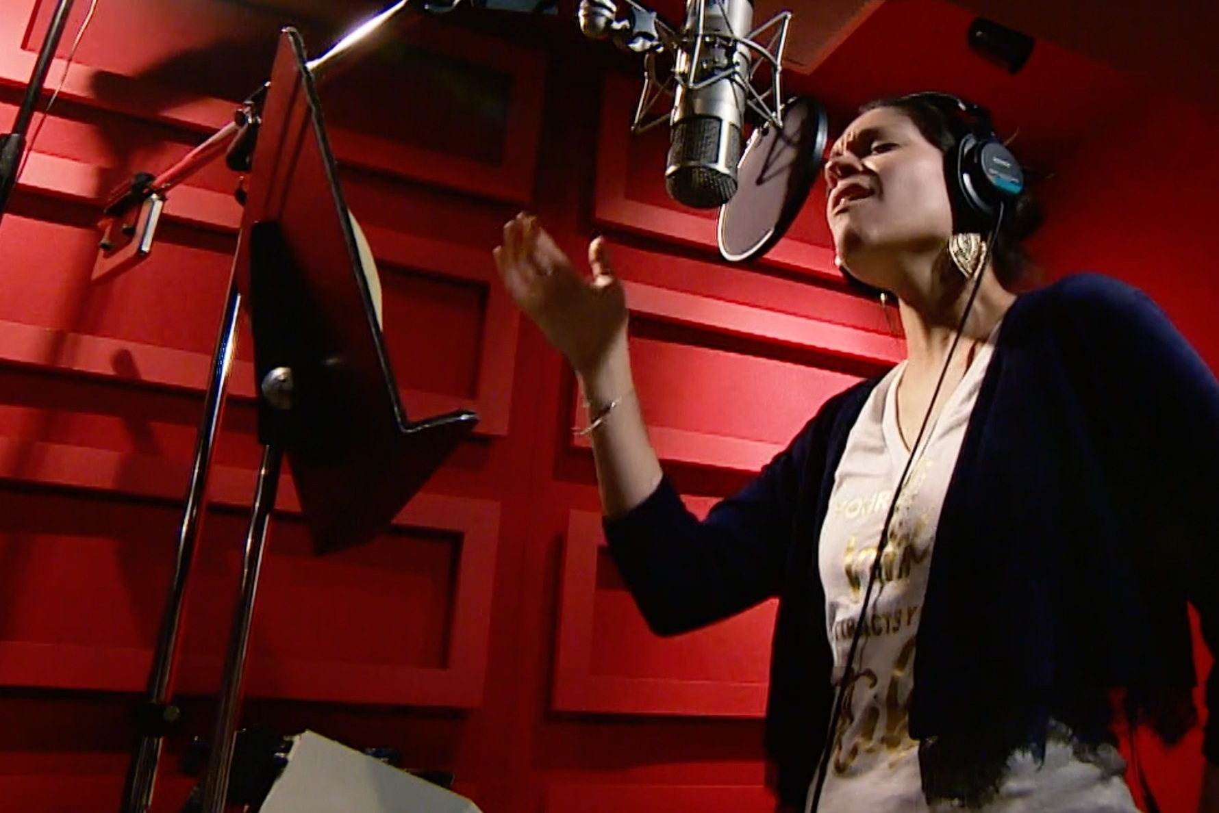 "Singer Eva Avila records the song ""Shine"""