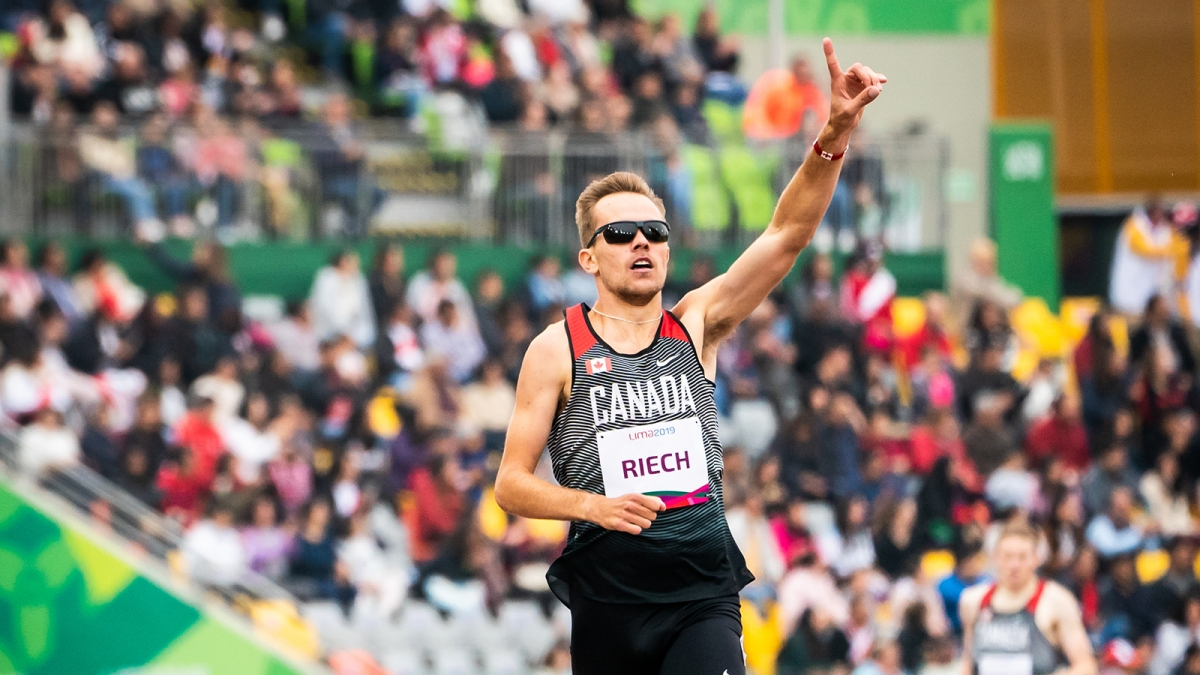Nate Riech celebrates after winning the gold medal in men's 1500m