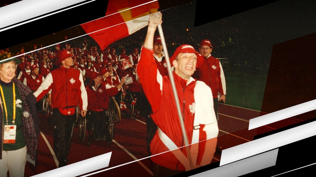 Para cyclist Gary Longhi leads Canada into the Opening Ceremony at the Sydney 2000 Paralympic Games