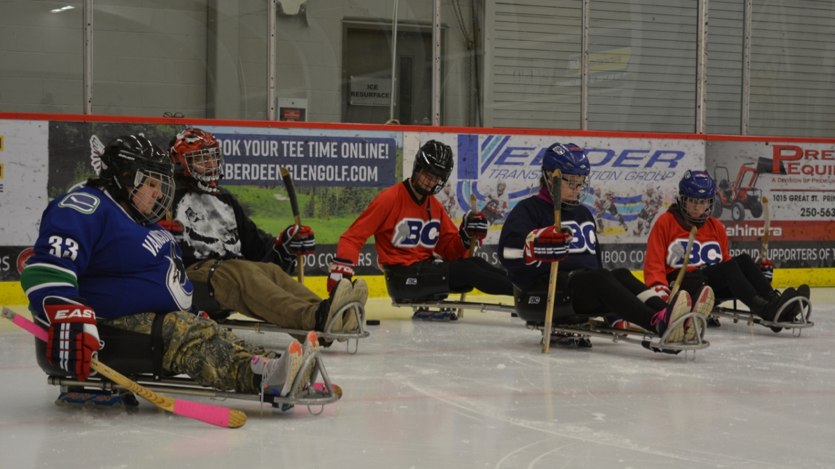 Northern Adapted Sports Association participants at a Para ice hockey session.