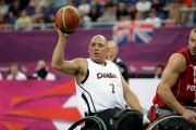 Richard playing wheelchair basketball