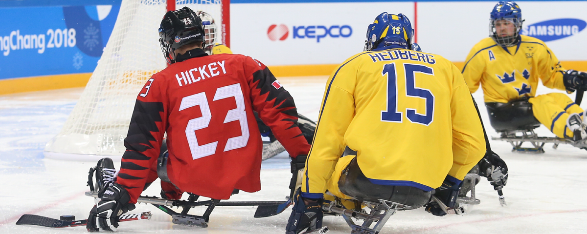 Liam Hickey shooting the puck against Sweden at the 2018 Paralympic Winter Games