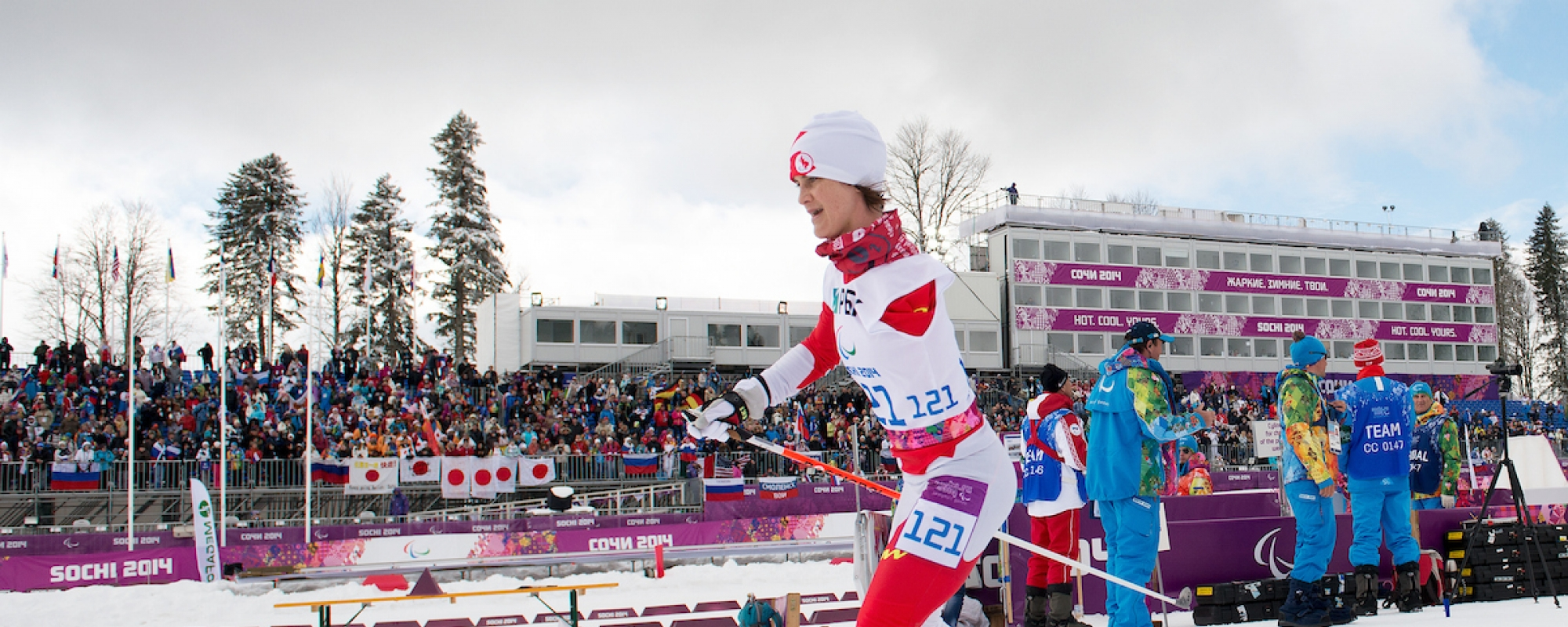 Caroline skiing in front of the stands
