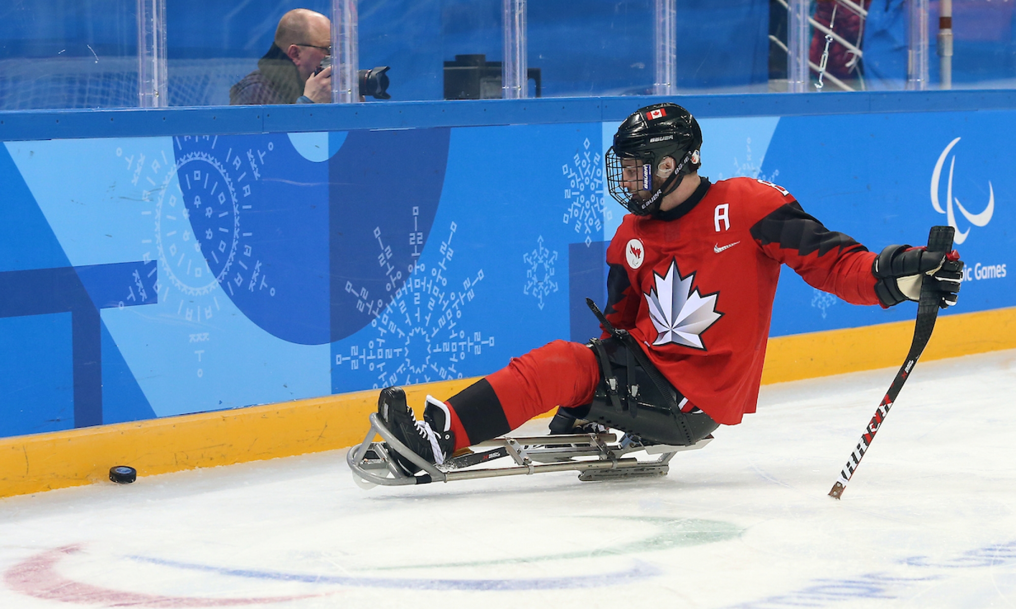 Tyler McGregor on the ice in his sledge