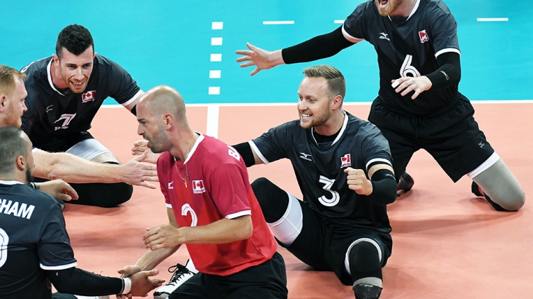 Sitting Volleyball celebrating a win on court