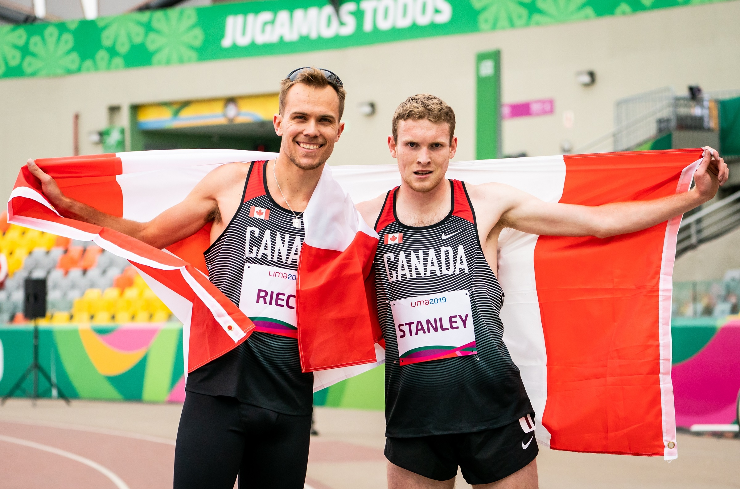 Nate Riech and Liam Stanley with the Canadian flag.