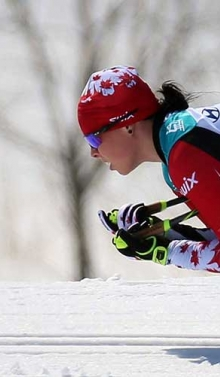 Cindy Oullet tucking as she goes downhill in para nordic