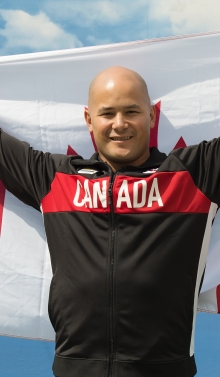 David Eng holding the Canadian flag