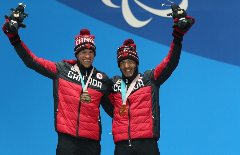 Brian McKeever on the podium with his guide Russell Kennedy
