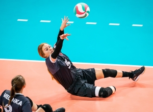 Payden Olsen volleys the ball in sitting volleyball action at the Lima 2019 Parapan Am Games
